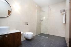 En suite bathroom with walk in shower